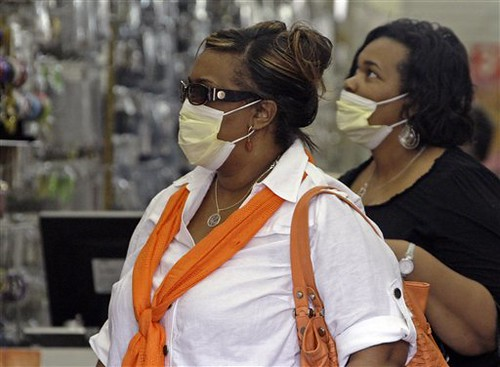 Women wearing surgical masks shop in the downtown Los Angeles Fashion District Wednesday, April 29, 2009. (AP Photo/Reed Saxon) by Pan-African News Wire File Photos