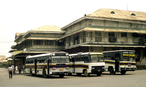 German Espiritu 3 buses a Fuso PES-730, unknown xxT-10x and Hino NXM-854 outside the Tutuban Railway Station, Manila, Philippines.