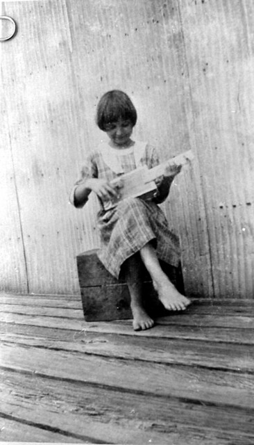 May Newman playing cigar box banjo she made: Palatka, Florida