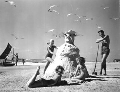 "Three girls making a ""sandman"" at the beach by State Library and Archives of Florida"