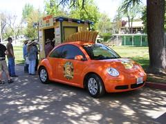 sedan(0.0), automobile(1.0), volkswagen beetle(1.0), wheel(1.0), volkswagen(1.0), vehicle(1.0), automotive design(1.0), volkswagen new beetle(1.0), subcompact car(1.0), city car(1.0), land vehicle(1.0),