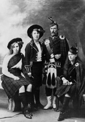 Four people in a variety of highland dress
