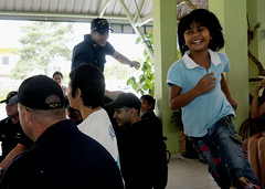 """KOTA KINABALU, Malaysia (May 6, 2011) Sailors stationed aboard USS Avenger (MCM 1) play a game of """"Duck, Duck, Goose"""" with children from the Bukit Harapan home for disabled and disadvantaged children. (U.S. Navy photo by Mass Communication Specialist 3rd Class Brian A. Stone)"""