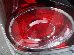 wheel(0.0), rim(0.0), alloy wheel(0.0), lighting(0.0), spoke(0.0), automotive tail & brake light(1.0), automotive exterior(1.0), vehicle(1.0), automotive lighting(1.0), red(1.0), light(1.0),
