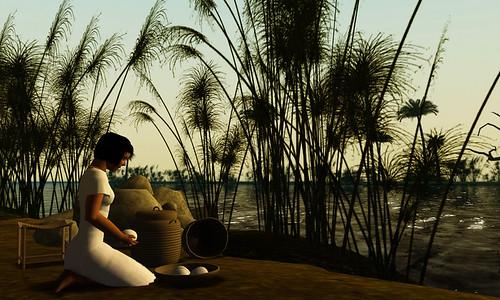 Servant girl kneeling by the Nile