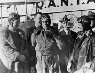 Aviatrix Jean Batten being interviewed after her flight from England to Australia, 1934.