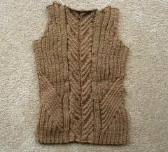 art(0.0), sleeve(0.0), cardigan(0.0), pattern(1.0), textile(1.0), brown(1.0), wool(1.0), clothing(1.0), outerwear(1.0), knitting(1.0), crochet(1.0), woolen(1.0), sweater(1.0),