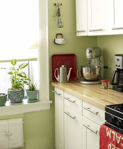 Green kitchen + white cabinets + red accents 'Sweet Caroline' by