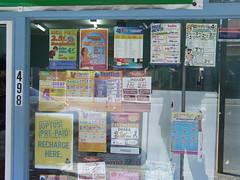 Signs in window of Indian Grocer, Ipswich Rd, Annerley Junction, Brisbane, Queensland, Australia 090617