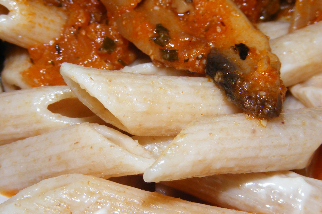 Whole grain penne in mushroom and tomato sauce