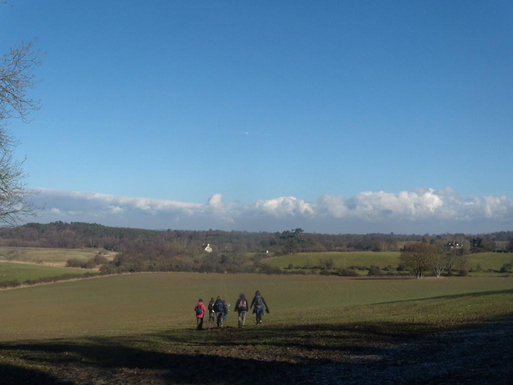 Off across a field A muddy field. Amberley Circular
