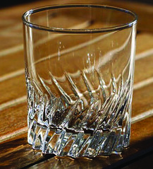 champagne(0.0), wine glass(0.0), whisky(0.0), wine(0.0), stemware(0.0), drink(0.0), lighting(0.0), alcoholic beverage(0.0), old fashioned glass(1.0), drinkware(1.0), distilled beverage(1.0), glass(1.0),
