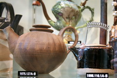 Teapot with Lid, 1974, mixed clays by Ragnar Naess and Teapot, 1998, glazed stoneware and metal by Byron Temple