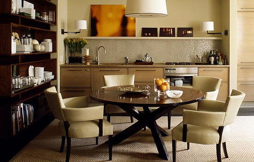 Clean, masculine dining room: Neutral palette + mid-century modern Danish round table + leather chairs