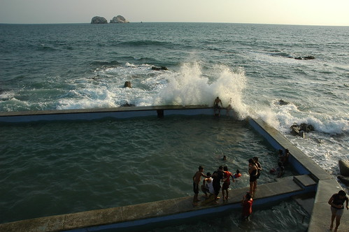 Back massage by wave splashing in! Pacific Ocean pool with kids and adults, South Mazatlan, Sinaloa, Mexico by Wonderlane