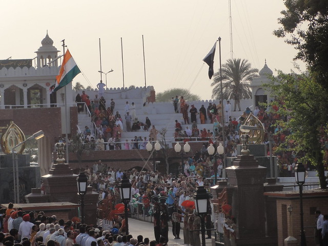 security personnel lowering the flag of their respective countries at Wagah Border