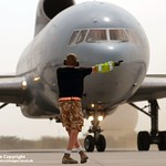 Ground Crew Member Directs a RAF Tristar Aircraft