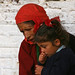 Woman and young girl outside of a school in Kaski, Nepal