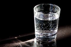 glass bottle(0.0), bottle(0.0), drink(0.0), alcoholic beverage(0.0), old fashioned glass(1.0), water(1.0), drinkware(1.0), distilled beverage(1.0), glass(1.0), cocktail(1.0),