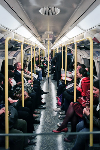 Travelling on the tube on the London underground.