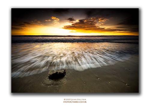 ocean sunset sea seaweed beach wales coast sand cymru wave spray coastal coastline aberavon porttalbot dapa seanbolton dapagroup ffotocymrucouk