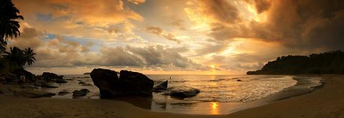 sunset panorama seascape beach clouds sumatra indonesia landscape nikon rocks shoreline wideangle tokina photomerge stitched lampung sumatera d80 krui lampungbarat nikonflickraward tebakak westlampung