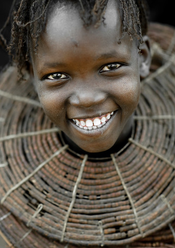Pokot tribe smiling girl with giant necklace - Kenya