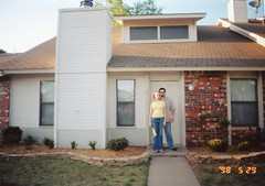 Will & Britt in front of their 1st home in Lawton,Ok-May 2005