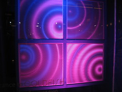 window(0.0), signage(0.0), electronic signage(0.0), glass(0.0), display device(0.0), flat panel display(0.0), purple(1.0), light(1.0), led display(1.0), neon(1.0), circle(1.0), neon sign(1.0), blue(1.0), lighting(1.0),