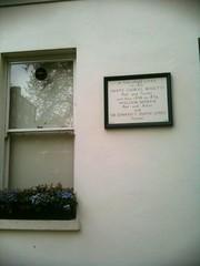 Photo of Dante Gabriel Rossetti, William Morris, and Edward Burne-Jones white plaque