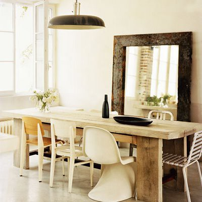Rustic, eclectic Paris loft: White dining room + oversized mirror + Panton chair