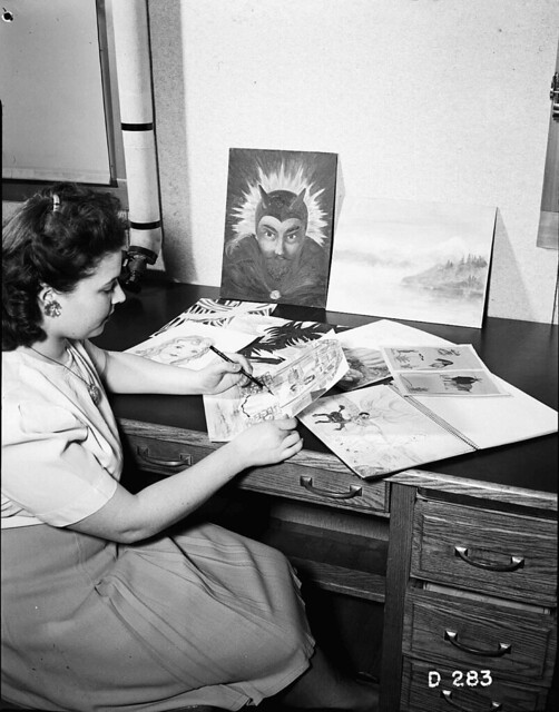 1944 HANFORD WOMAN REVIEWING ART WORK