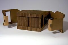 shelf(0.0), furniture(0.0), wood(0.0), carton(0.0), box(0.0), lighting(0.0), cardboard(1.0),