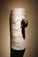 hand(0.0), lamp(0.0), light fixture(0.0), lampshade(0.0), vase(0.0), bracelet(0.0), dress(0.0), lighting(0.0), art(1.0), sconce(1.0), black(1.0),