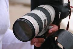 cinematographer(0.0), cameras & optics(1.0), camera(1.0), photograph(1.0), mirrorless interchangeable-lens camera(1.0), digital slr(1.0), close-up(1.0), camera operator(1.0), camera lens(1.0), black(1.0), reflex camera(1.0),