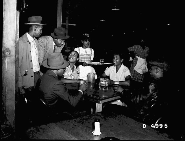 WAITRESSES SERVING DRINKS TO CUSTOMERS
