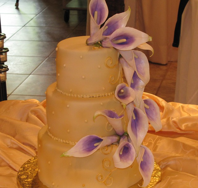 Ivory and Purple Wedding Cake Dark ivory fondant then airbrushed lightly