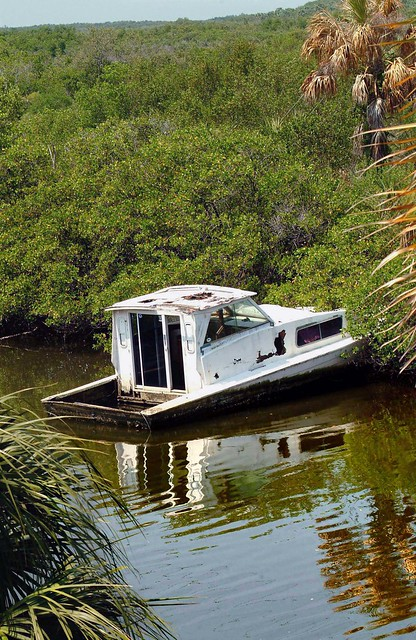 Abandoned boat near the old giants fish camp in gibsonton for Fish camping boat