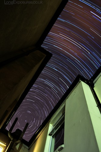 Tight Space: Star trails between the houses by AndWhyNot