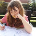 Small photo of M does homework in april sun