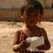 Little Burmese Girl with Puffed Rice Crisps - Kalaw, Burma by uncorneredmarket