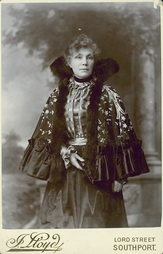 Woman wearing an opera cape, 1898