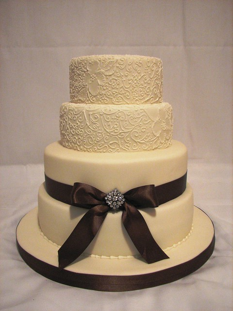 ivory and brown wedding cake by cakeladycakes
