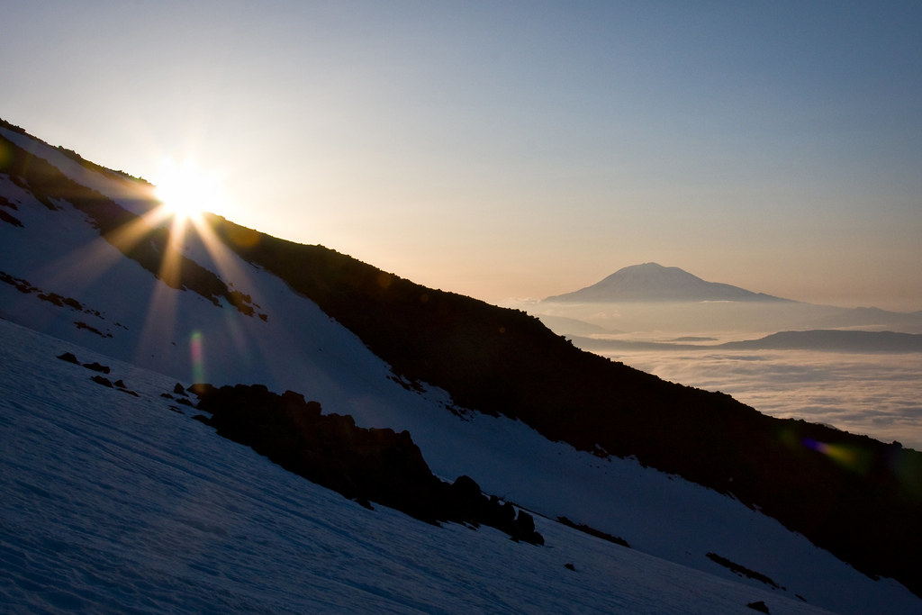 Sun rising over Mount Adams