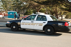 automobile, ford crown victoria police interceptor, vehicle, police car, sedan, ford crown victoria, luxury vehicle, person,