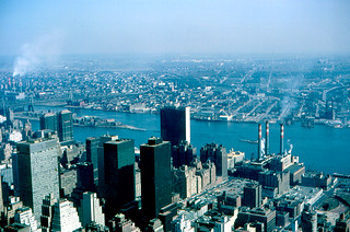 Image of United Nations Headquarters near Long Island City. newyork building river manhattan air mobil un unitednations eastriver empirestatebuilding 1965 secretariat midtownmanhattan soconymobil