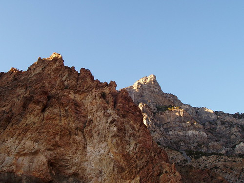 The summit of Squaw Peak behind the orange walls of Rock Canyon.