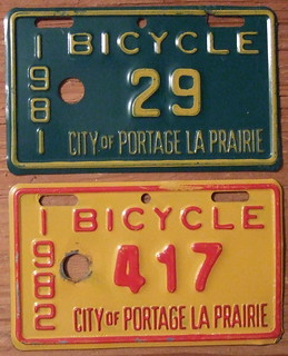 MANITOBA, PORTAGE LA PRARIE 1981 and 1982 BICYCLE LICENSE plates