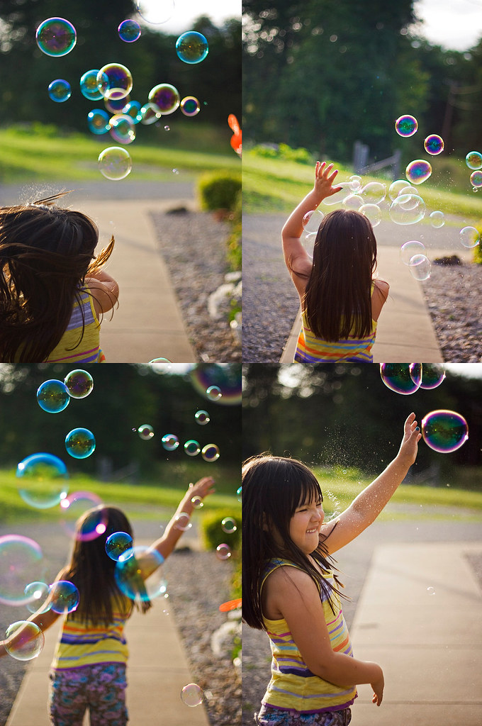 Emi playing in bubbles