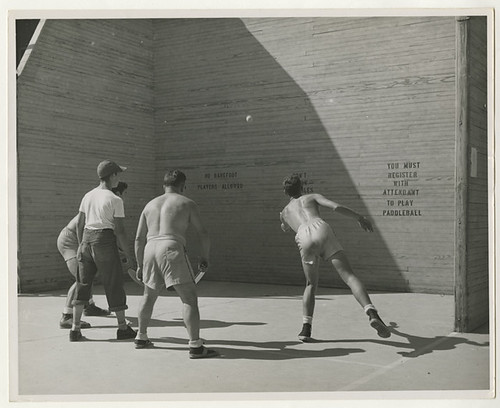 Men and boys playing paddleball, Cincinnati, Ohio, circa 1950